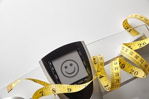 Scale with happy face message
