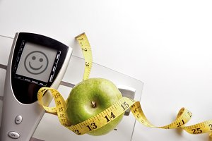 Scale with happy face message apple