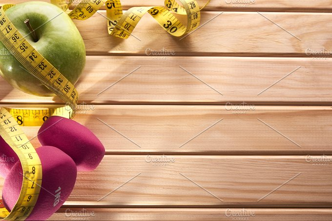 Sport and nutrition concept for women on wood top view.jpg - Health