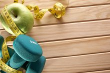 Sport and nutrition concept on wood top view.jpg