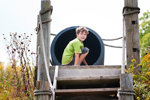 boy at the top of a slide
