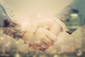 Business people handshake. Vintage