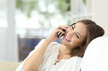 Girl talking on the mobile phone at home.jpg