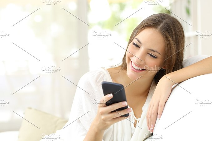 Girl reading message in a smart phone.jpg - Technology