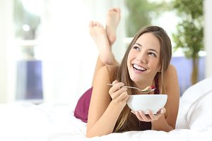 Healthy girl eating cereals at breakfast.jpg