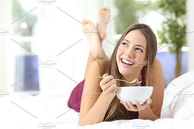 Healthy girl eating cereals at breakfast.jpg - Food & Drink