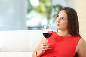 Pensive relaxed woman with a cup of wine.jpg
