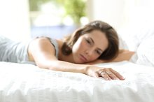 Sad girlfriend missing her boyfriend on the bed.jpg