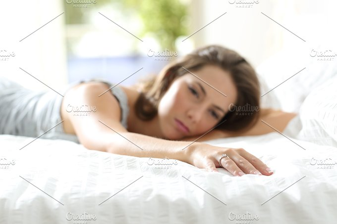 Sad girlfriend missing her boyfriend on the bed.jpg - People