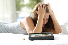 Sad wife missing her husband after divorce.jpg