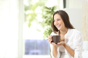 Woman drinking coffee or tea at home.jpg