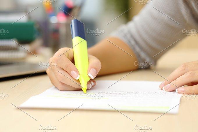 Woman hand underlining a document.jpg - Education