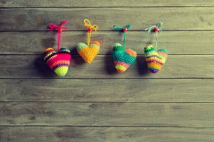 Knitted hearts of different colors