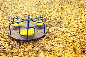 Lonely abandoned carousel at autumn