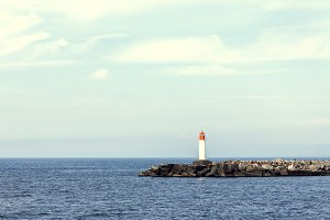 Landscape with white lighthouse