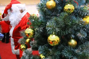 Santa claus and new year tree