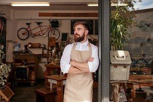 Cafe owner standing in the doorway