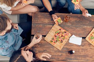 Friends having drinks and pizza