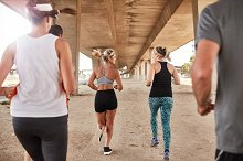 Runners in fitness clothing running