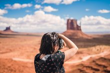 Tourist photographer woman taking pi