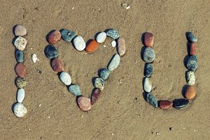 Love words written on the beach