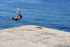 Boy jumping in the sea