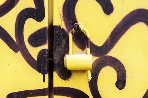 Graffiti painted doors with lock