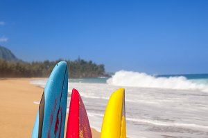 Three surfboards by stormy ocean