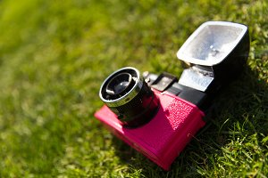 Retro pink camera with flash