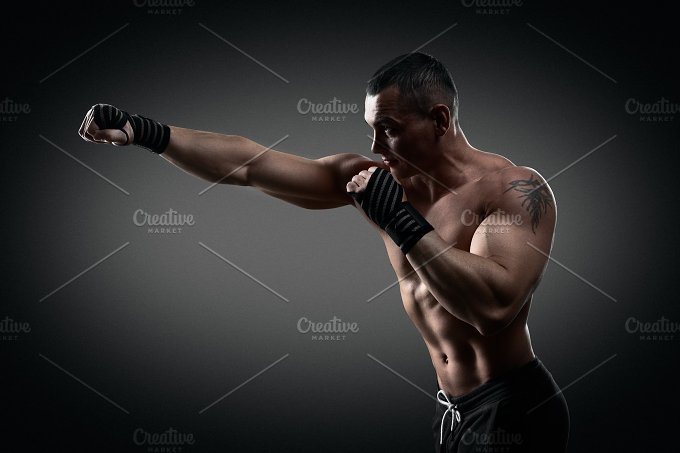 Fighter boxer on black background - Sports
