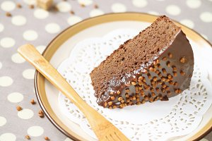 A piece of chocolate cake with choco