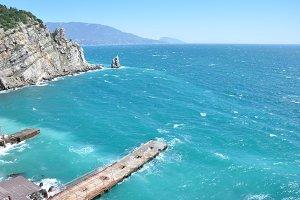 Wavy sea and a pier