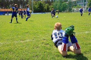 Boy watching soccer match