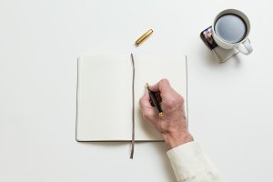 Senior caucasian man writing