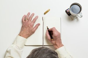 Senior businessman making notes