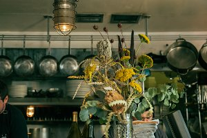 Old Flowers In A Restaurant
