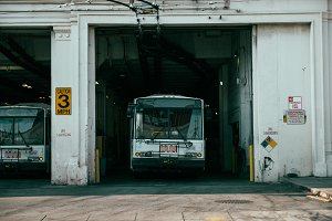 City Bus Parked in a Garage