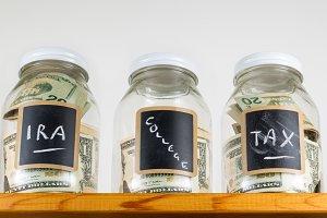 Three savings jar on high shelf