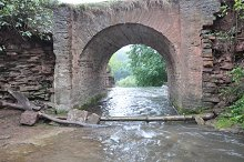 Arch Stone Bridge in mountain river