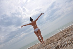 Young girl in a bikini looking at se