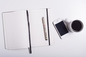 Office desk with notepad and pen