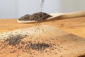 Black Chia seeds pour into spoon