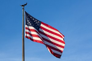 USA American flag blowing in wind