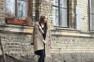 beautiful woman in coat looking away