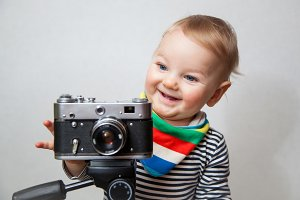 One year boy with camera