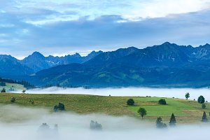 Sunrise and summer misty mountain.