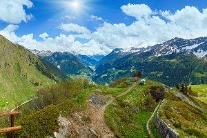Summer Alps mountain pass panorama.