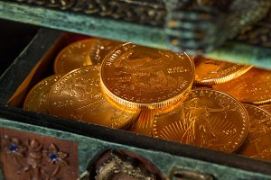 Gold coins inside treasure chest