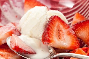 Strawberries and ice cream in dish