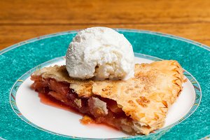 Slice of mom's apple pie with cream